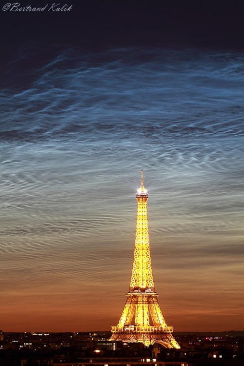 Noctilucent clouds over Paris on June 21, 2019. Photo credit- Kulik Bertrand. For more images, browse the Noctilucent Cloud Photo Gallery.