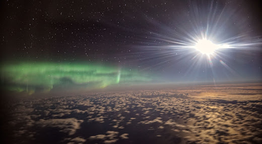 Flying high above the clouds, astronomer Ian Griffin photographed an outburst of auroras from NASA's SOFIA aircraft on July 10th.